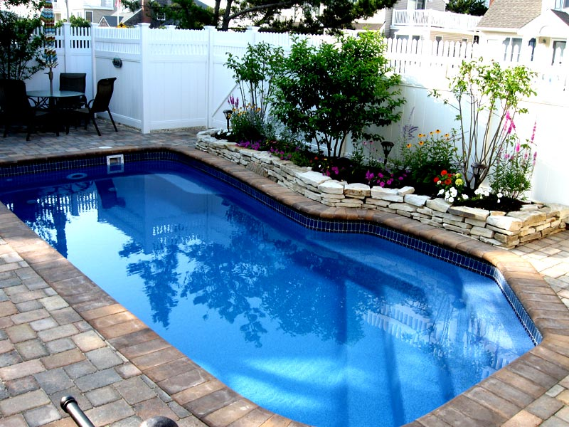 Pool designs inc swimming pool perimeter inlayed for Pool designs yardville nj